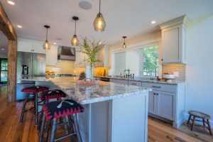 kitchen design with gray cabinets and granite countertops